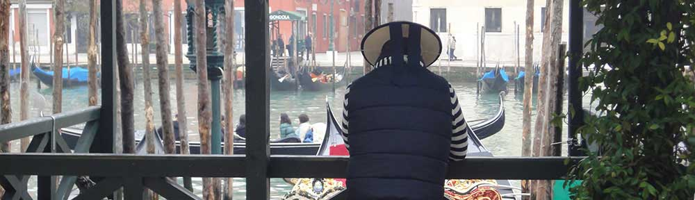 gondolier-venice-by-canal